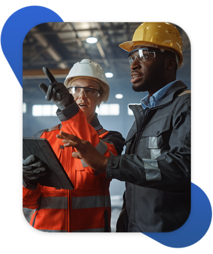 Manufacturing employees discussing plant operations