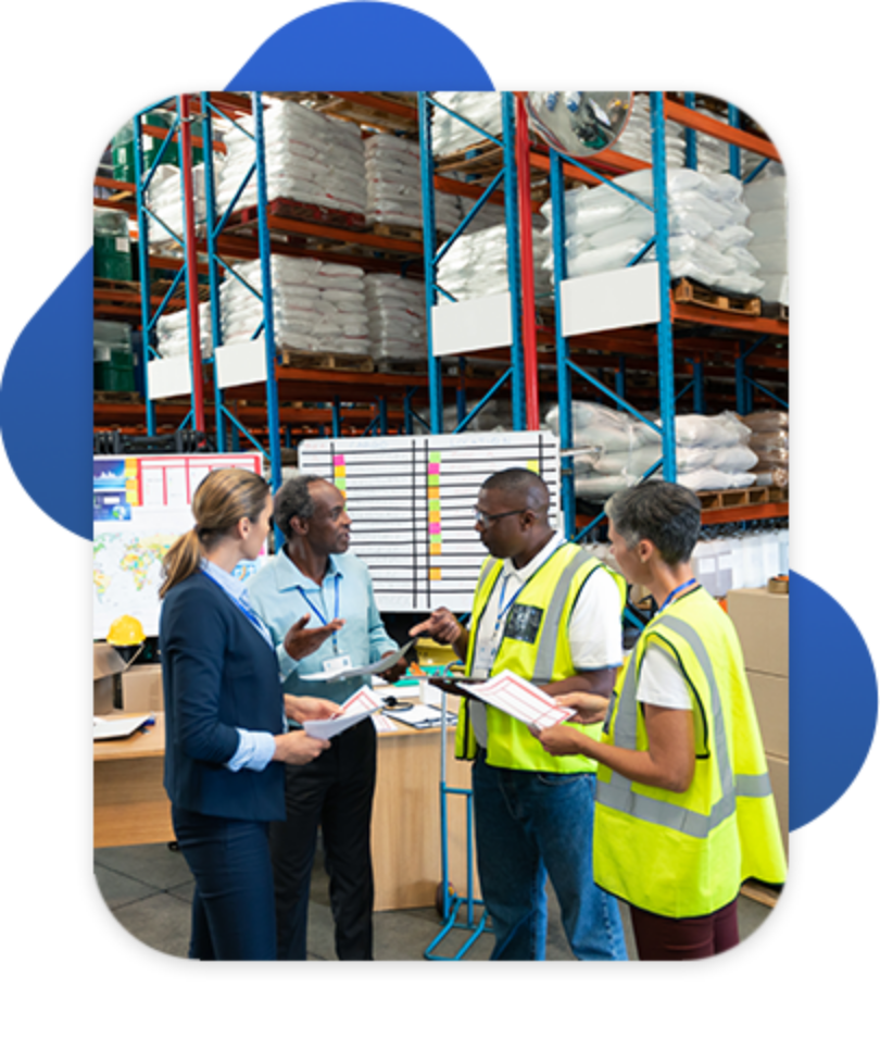 Group of distribution employees discussing warehouse strategy
