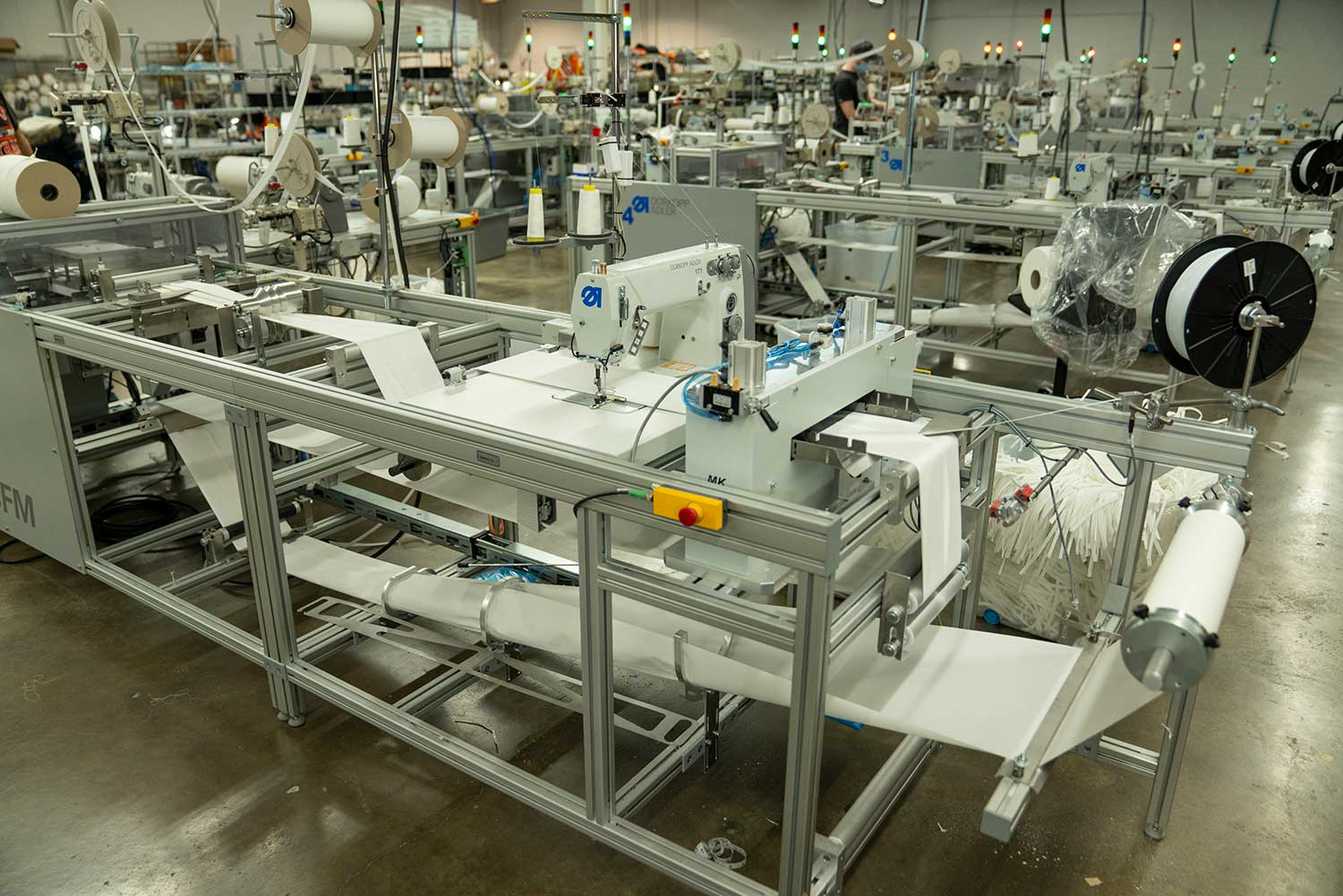 Mask producing sewing machines