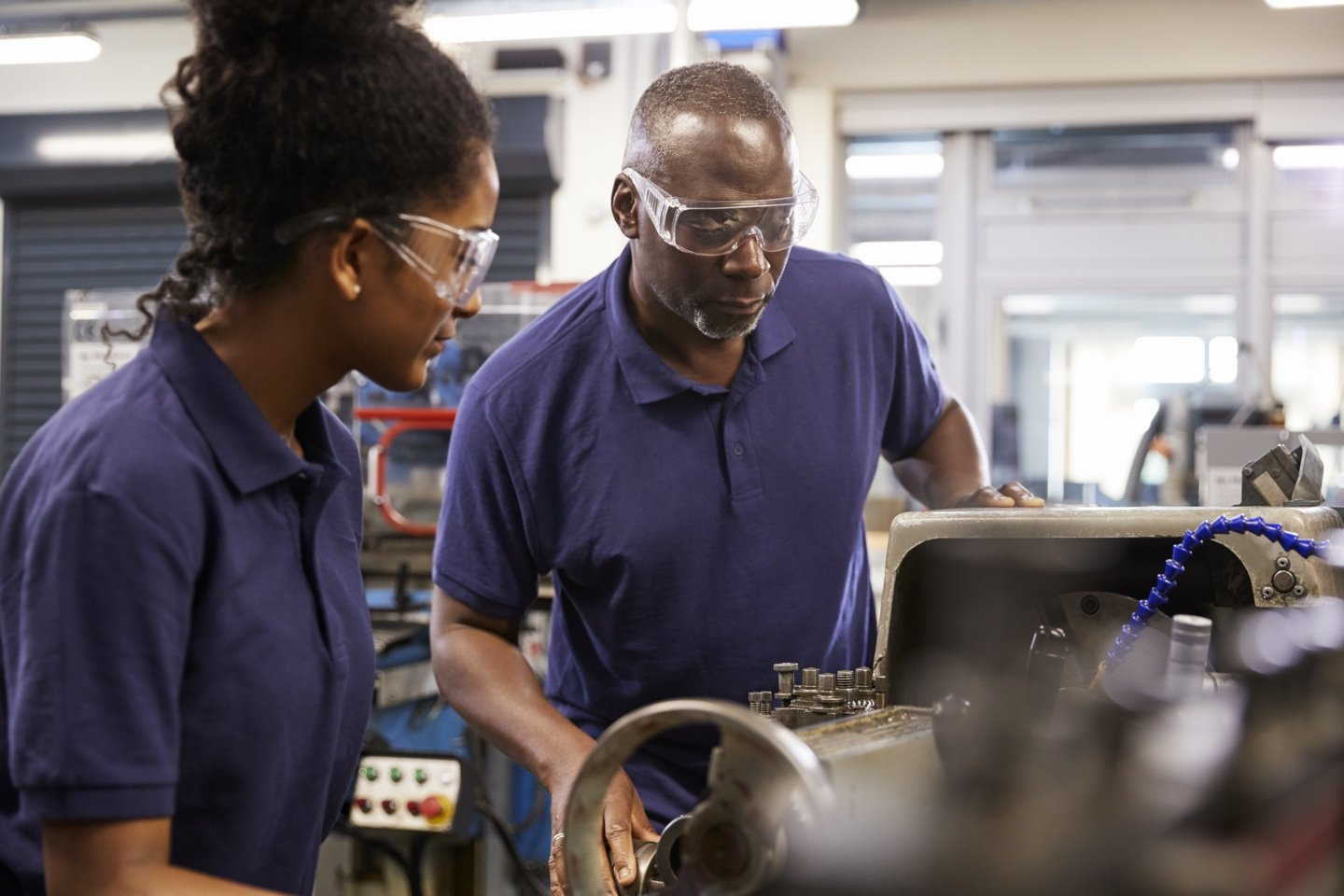 Manufacturing workers using equipment
